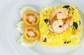 pic of yellow-pepper  - Garnished Yellow Fried Rice with shrimps Yellow Curry Powder white onions bell pepper and minced garlic cucumber on the side - JPG