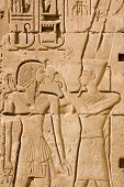image of ankh  - An Ancient Egyptian hieroglyphic carving of the King God Amun Ra with the Pharaoh Ramses II - JPG