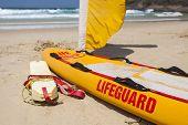image of lifeguard  - Lifeguard equipment on sunny tropical Australian beach - JPG