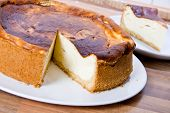 picture of cheesecake  - cut cheesecake on white plate close up - JPG
