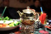 picture of teapot  - The glass teapot on a table in the asian restaurant - JPG