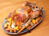 stock photo of turkey dinner  - roast turkey dinner with seasonal vegetables for a family holiday meal - JPG