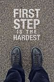 stock photo of motivational  - First Step is the Hardest Motivational Message on Street Pavement - JPG