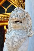 stock photo of guardian  - antique guardian lion sculpture in front of the temple thailand - JPG