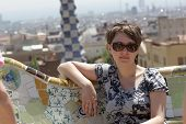 Girl Sits On Bench At Park Güell