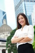 pic of arms race  - Business woman smiling portrait in Hong Kong - JPG