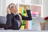 image of leader  - Happy young business woman enjoying success at work - JPG