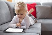 picture of clever  - Young girl using tablet computer at home - JPG
