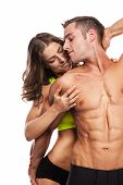 foto of hot couple  - sexy couple muscular man holding a beautiful woman isolated on a white background - JPG
