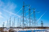 picture of transmission lines  - High voltage transmission line on the background of blue sky - JPG