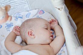 foto of sweet dreams  - cute baby sleeping sweetly in the cradle at home - JPG