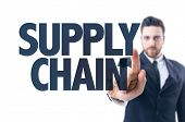 stock photo of supply chain  - Business man pointing the text - JPG