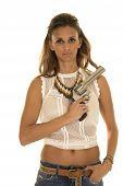 stock photo of revolver  - A woman in her lace top with a revolver on her shoulder - JPG
