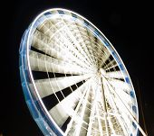 stock photo of observed  - Ferris observation wheel in Poland Gdansk Old Town night view - JPG