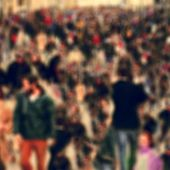 pic of pedestrians  - defocused blur background of people walking in a busy pedestrian street - JPG