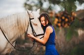 foto of horse girl  - Beautiful girl with horse and long hair - JPG