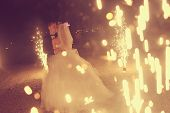 picture of firework display  - Bridal couple dancing sorrounded by fireworks on their wedding day - JPG
