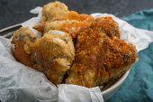 stock photo of crisps  - Crisp crunchy golden chicken wings on a dark table - JPG