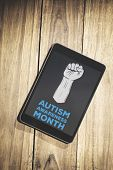 pic of aspergers  - Autism awareness month against overhead of tablet on desk - JPG