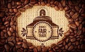 picture of oval  - Fair Trade graphic against coffee beans with oval indent for copy space - JPG