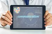 picture of autism  - The word communication and autism awareness heart against medical biology interface in blue - JPG