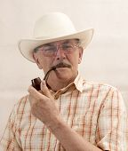 stock photo of hillbilly  - Cowboy in white hat with Pipe on white background - JPG