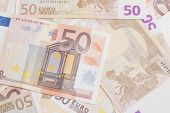pic of fifties  - Closeup of a group of fifty euros banknote background - JPG