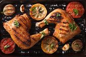stock photo of grill  - Two grilled chicken legs and vegetables on the grill pan close - JPG