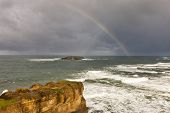 stock photo of punchbowl  - A rainbow over the Pacific Ocean as seen from Devil - JPG