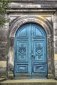 picture of memento  - ancient grungy blue gate to a tomb - JPG