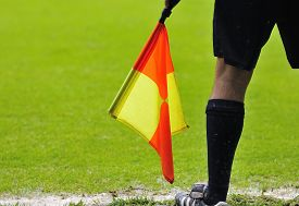 pic of referee  - Assistant referees in action during a soccer match - JPG