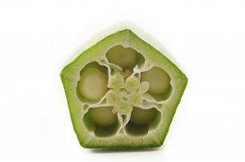 image of okras  - fresh okra slice on a white background - JPG