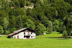 picture of barn house  - Typical old farm house with barn in mountain - JPG