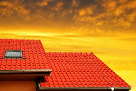 pic of red roof  - Roof house with tiled roof at sunset - JPG