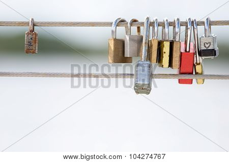Постер, плакат: Love Locks Hanging From A Cable Railing, холст на подрамнике