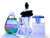 picture of perfume bottles  - it is a beautiful photo of a couple of perfume bottles - JPG
