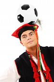 Polish Man In A Traditional Outfit With Football On Head poster