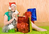 picture of tawdry  - teenager girl with Christmas gifts and two pet rabbits - JPG