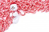 picture of candy cane border  - Mini candy canes making a border on a white background Candy cane border - JPG