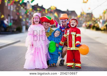 poster of Kids And Parents On Halloween Trick Or Treat