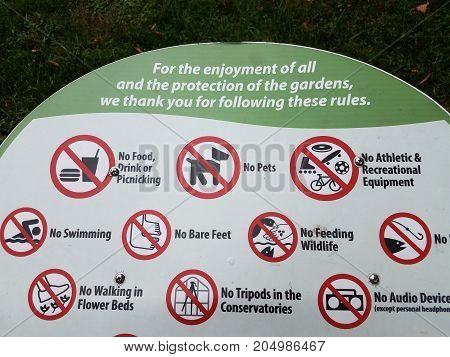 a sign in a garden showing all of the prohibited things
