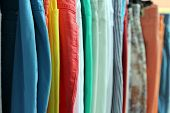 Shallow Focus Shot Of Colorful Trousers And Jeans On A Shop Rail poster