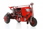 image of workhorses  - An old retro red tractor over a white background - JPG