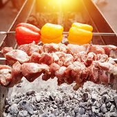 Постер, плакат: Grilled Kebab Cooking On Metal Skewer Roasted Meat Cooked At Barbecue With Red And Yellow Bell Pep