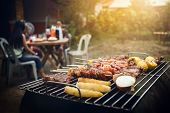 Bbq Grill With Pork And Vegetable On Fire. poster