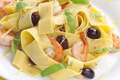 picture of italian food  - Shrimp lemon pepper Pappardelle pasta with fresh basil and black olives - JPG
