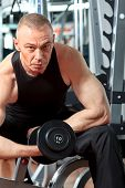stock photo of mature men  - Mature sporty man in the gym centre - JPG
