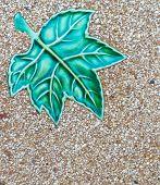 picture of terrazzo  - glazed tile maple leaf and terrazzo floor - JPG