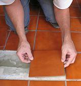 stock photo of ceramic tile  - Laying ceramic tile - JPG