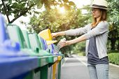 Waste Management, Woman Throwing Plastic Bottle Into Recycle Bin. Waste Separation Rubbish Before Dr poster